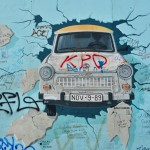 Old Eastern Bloc car breaking through the wall