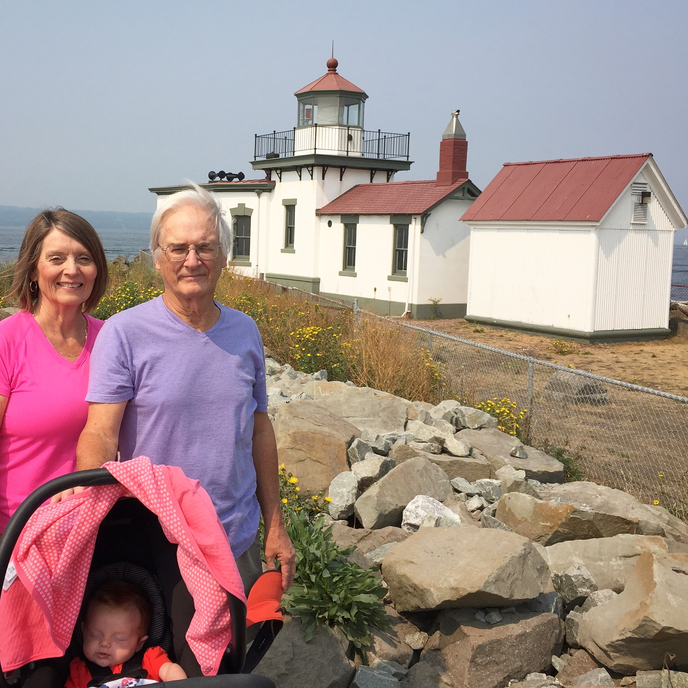 My mom and Dad with Stella by the Discovery Park Lighthouse