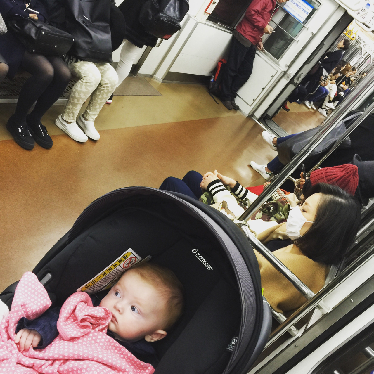 Stella on her first train ride in Japan