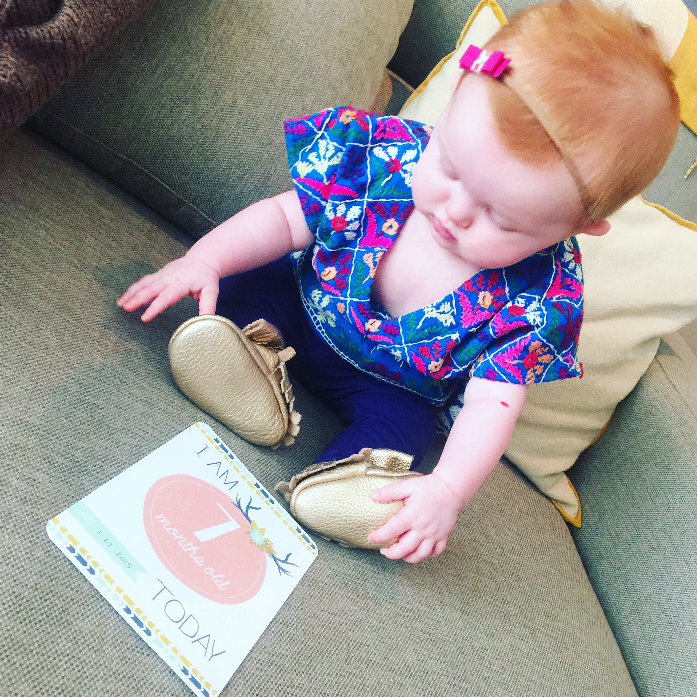 Studying her shoes, her newest fascination
